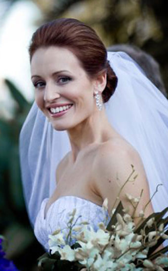 Smiling bride with a upstyle hairstyle