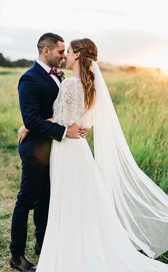Newlywed Couple In Field